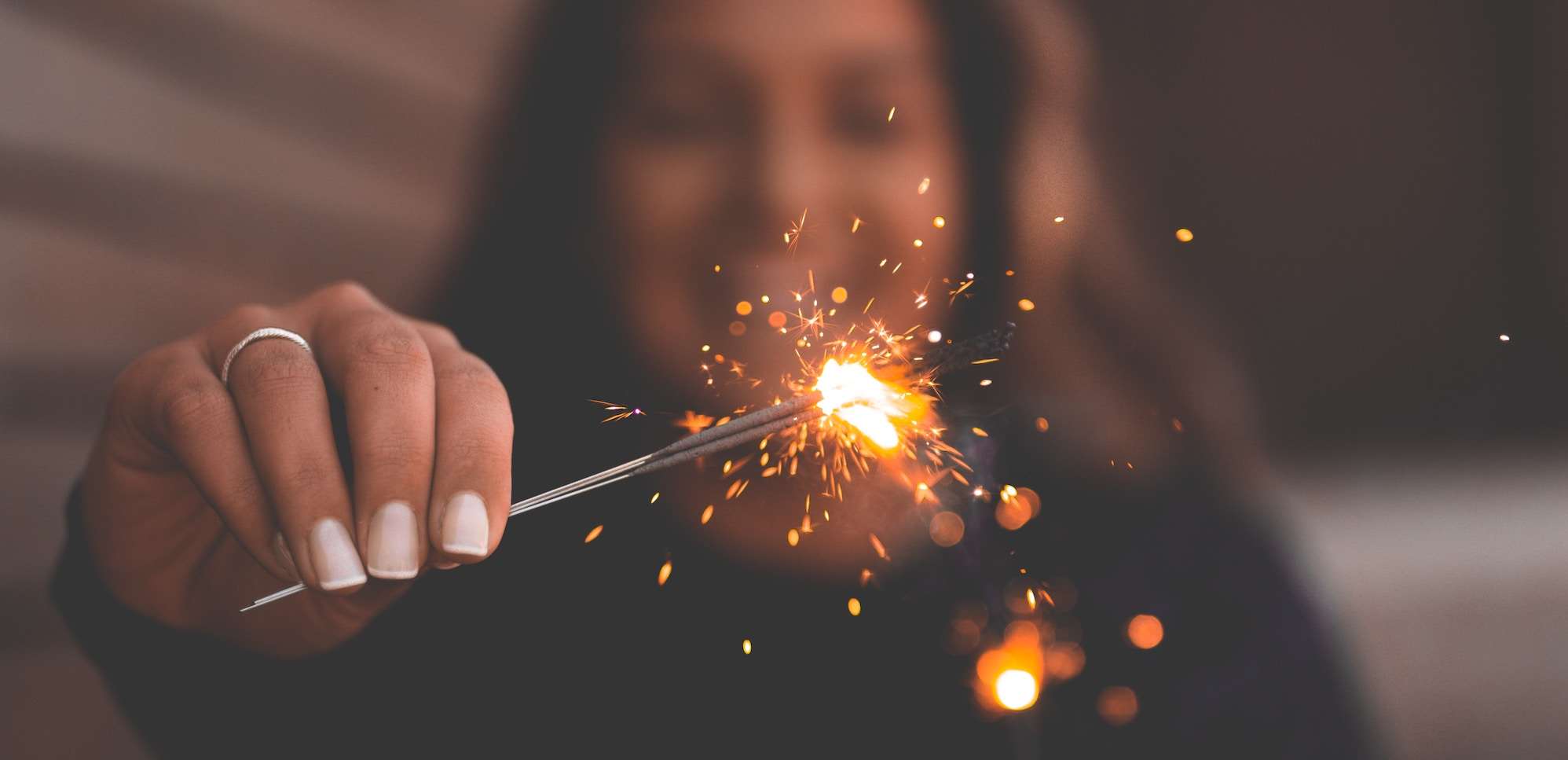 woman with a sparkler